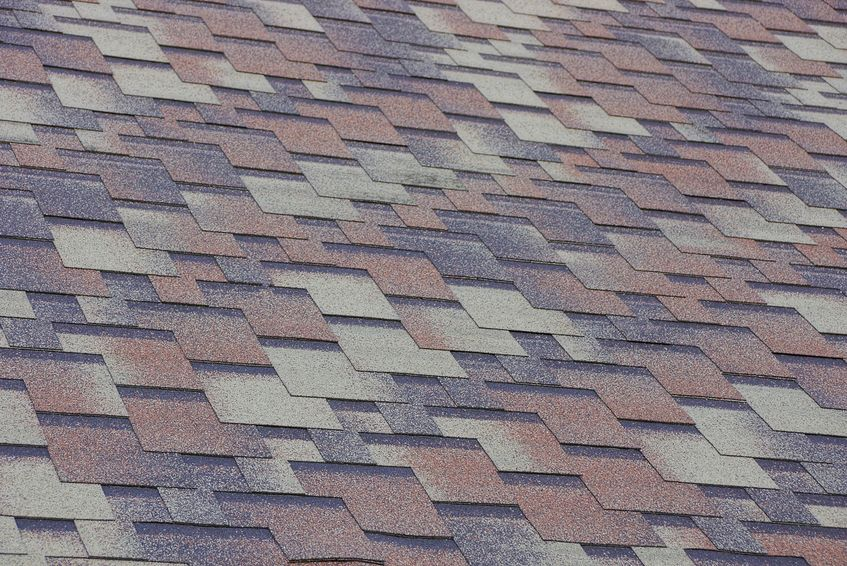 gray brown tile texture on the roof of the building